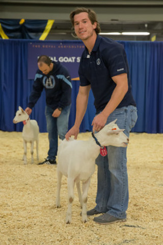 Argos kicker Swayze Waters and a goat at the 2015 Royal Agricultural Winter Fair (CNW Group/Royal Agricultural Winter Fair)