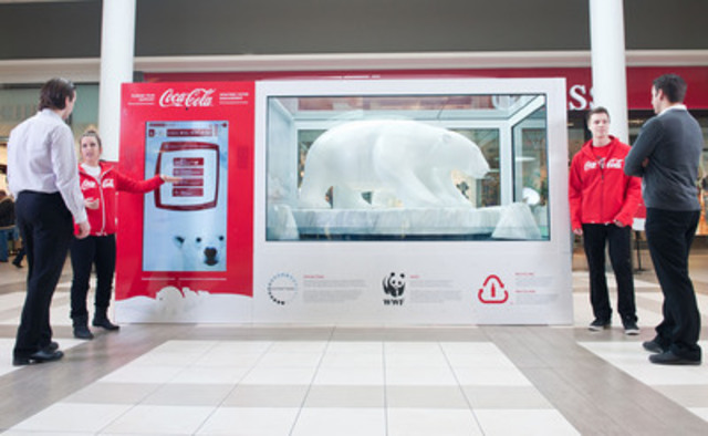 The Coca-Cola Arctic Home display at Carrefour Laval demonstrates how climate change affects polar bears and features a large-scale reproduction of an Inuit sculpture of a mother and her cub. For every pledge made, the temperature inside the installation will decrease, keeping the ice frozen and the climate ideal for polar bears. (CNW Group/Coca-Cola Canada)