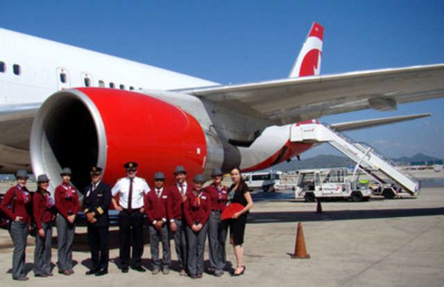 Air Canada rouge Montreal Barcelona 3 - pilots, rouge crew and Rosemary Capparelli (far right - Senior Director of Finance for Air Canada rouge) in front of an Air Canada rouge Boeing 767-300ER after landing in Barcelona on 5 June 2014 (CNW Group/Air Canada rouge)