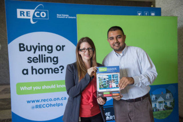 Visitors take a photo with their dream home at the Be Home Smart booth (CNW Group/Real Estate Council of Ontario)
