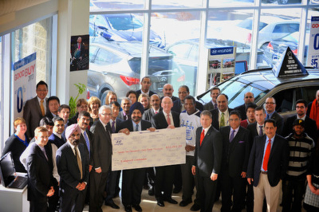 Nav Bhatia, dealer principal of Mississauga Hyundai (http://www.mississaugahyundai.com/), presents a $22,063 donation for the Hyundai Hockey Helpers (http://www.hyundaihockey.ca) initiative to Hyundai Auto Canada Corp. (http://www.hyundaicanada.com) President and CEO Steve Kelleher, Hyundai Hockey Helpers Ambassador Karl Subban, and KidSport Canada representatives. (CNW Group/Hyundai Auto Canada Corp.)