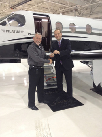 Stan Kuliavas (right), Director of Sales at Pilatus Centre Canada delivers a brand-new Pilatus PC-12 NG to David Wickware, Director of Aviation at American Iron and Metal. (CNW Group/Pilatus Centre Canada)