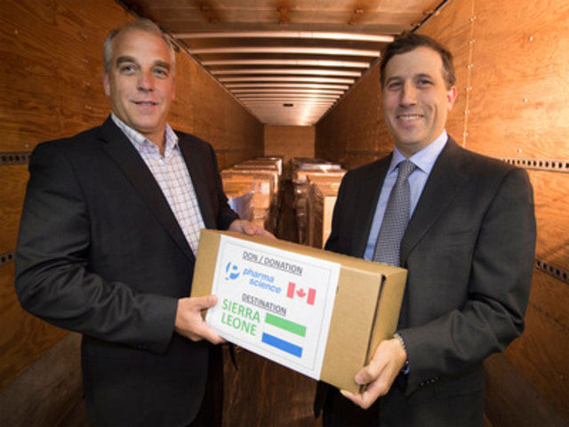 David Goodman, right, Chief Executive Officer, Pharmascience Inc., makes a symbolic presentation of a box of the company's Pediatric Electrolyte cholera treatment to Michel Harpin, Executive Director, Industry Relations, Health Partners International of Canada (HPIC), inside a trailer being loaded at a Pharmascience distribution centre in Montreal, Quebec. Pharmascience donated 15 pallets of the treatment to HPIC for immediate shipment to Sierra Leone to fight a serious outbreak of cholera in the West African country. (CNW Group/Health Partners International of Canada)