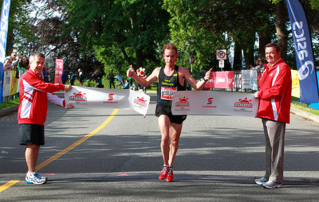 Reid Coolsaet of Hamilton, ON crosses the finish line at the Scotiabank Vancouver Half-Marathon on June 24, 2012. Coolsaet placed first with a time of 1:03:16, just five seconds shy of the course record. (CNW Group/Scotiabank - Sponsorships & Donations)