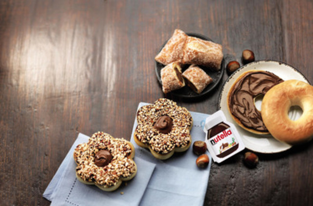 Available by April 15, 2015, for a limited time, Tim Hortons will offer irresistible new baked goods made with Nutella®. The new must-try products feature a Chocolate Hazelnut Donut filled with Nutella® and Pastry Pockets filled with Nutella®. Guests can also now choose a Nutella® Spread option for any bagel. (CNW Group/Tim Hortons)