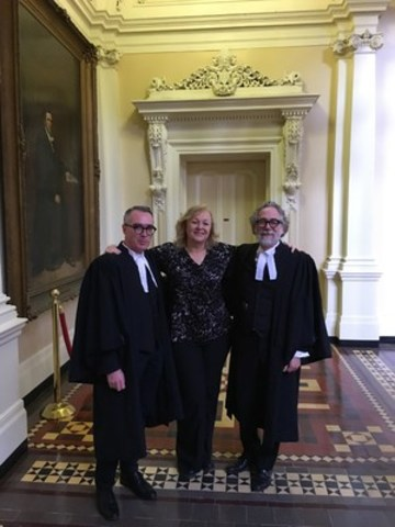 Marilou Martin, chair of OPSEU's college support workers division, with the lawyers following the Divisional Court decision. (CNW Group/Ontario Public Service Employees Union (OPSEU))