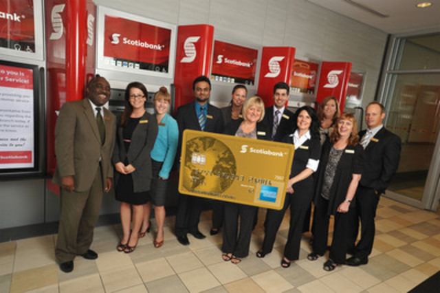 Just landed! Scotiabank employees at the Queenston & Nash branch in Hamilton, Ontario celebrate the arrival of the new Scotiabank American Express® Cards - a suite of loyalty cards designed for travel enthusiasts.(CNW Group/Scotiabank - Products & Services)