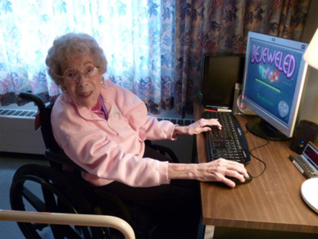 Email has surpassed face time as a main way to keep in touch with family for online seniors over 75, according to the Revera Report on Tech-Savvy Seniors.  At almost 105, Calgary's Evelyn regularly gets photos and updates from family via email at Revera's Bow-Crest Long Term Care Residence.  (CNW Group/Revera Inc.)