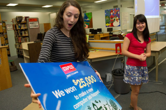 Sadie DeCoste, student at New Westminster Secondary School reacts to the news that her school won a computer lab worth $25,000 in the Staples Canada Recycle for Education Computer Lab Contest, as fellow student Sophie Labrosse looks on. (CNW Group/Staples Canada Inc.)
