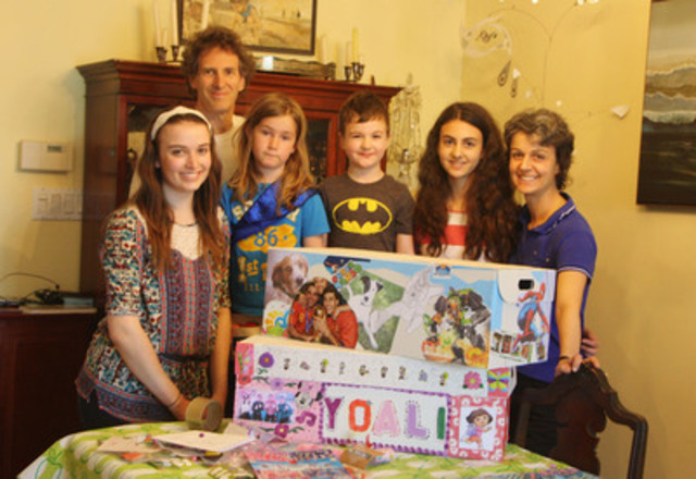 Stevenson family and community friends decorate a wish box. Back row Matthew Stevenson, front left to right Sophie Stuart-Sheppard, Lulu Grieve, William, Angela and Mondy Stevenson. (CNW Group/The Children's Wish Foundation of Canada)