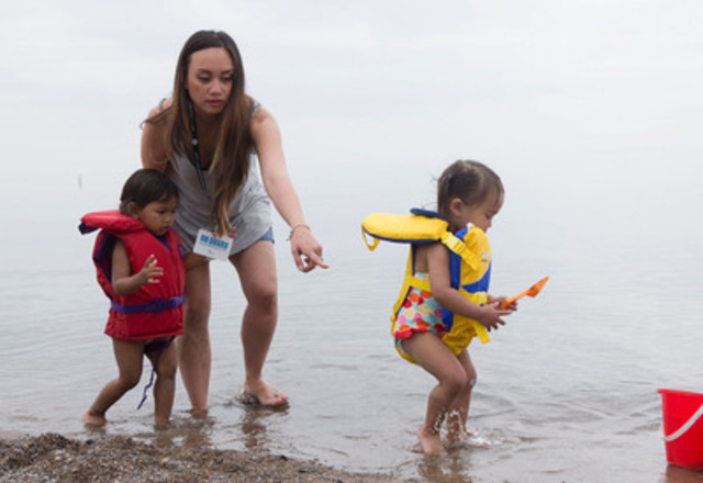 Nadia Luck supervises Nina and Reagan during a Lifesaving Society water safety event to launch the new ON GUARD card at Woodbine Beach in Toronto on Wednesday, June 25, 2014. (CNW Group/Lifesaving Society)