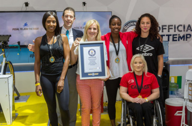 Chevrolet set a new Guinness World Records(TM) title for most number of people generating electricity in one week, powered by Chevrolet Volt secondary-use battery technology. Photographed: Sasha Exeter, fitness expert, Melanie Hawtin, TORONTO 2015 Parapan athlete, Carmelina Moscato and Robyn Gayle, 2012 Olympic bronze medallists, Philip Robertson, Guinness World Records(TM) and Danielle Ellis, Chevrolet. (Photo Credit: Mike Edge) (CNW Group/General Motors of Canada Limited)