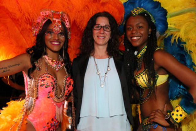 Catherine Paisley, Vice-President, Science Education and Experience, Ontario Science Centre (centre), poses with Azalea Hart, Face of the Festival (left), and a parade masquerader at the media launch for the 49th annual Toronto Caribbean Carnival, which was held at the Centre today. (CNW Group/Ontario Science Centre)