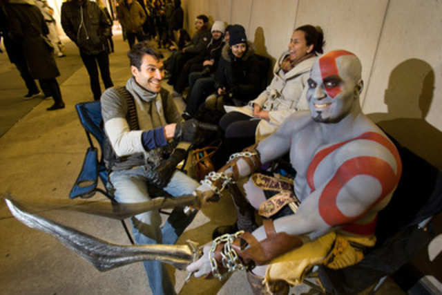 Nathan Drake and Kratos take a break while lining up at Best Buy in Toronto for the launch of PlayStation 4. (CNW Group/Sony Computer Entertainment Inc.)