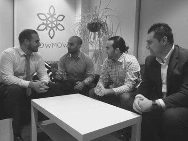 SnowMowr Co-Founders (from left to right) Tyler Meilleur, Omid Manoussi, Bryce Potter, and Mirza Matinjanin discussing final edits to their on demand snow and lawn care services application. They are set to launch in certain cities across Canada in early January of 2016 in the iTunes Store and Google Play. (CNW Group/Snowmowr)