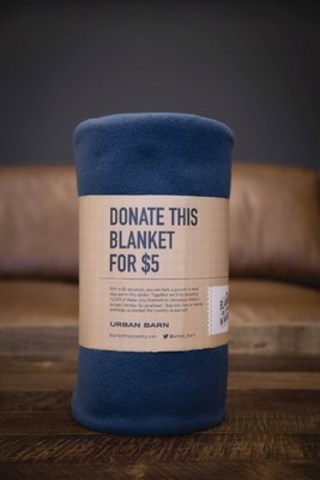 Urban Barn, Canadian furniture and home décor company, launches its Fourth Annual Blanket the Country in Warmth campaign. For every $5.00 donation, a brand new fleece blanket will be donated to a local shelter within an Urban Barn community. The initiative runs November 12 - December 6, 2015. (CNW Group/Urban Barn)
