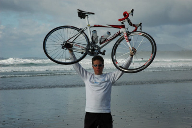 Mental health advocate Michael Schratter completed his epic worldwide solo cycling journey in Vancouver today after crossing six continents and 33 countries over 469 days. (CNW Group/Canadian Mental Health Association, BC Division)