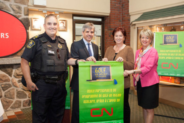 Sergeant Sylvain Ouimet, CN Police; Jean-François Houle, Chair of the Des Chênes school board; and Johanne Marceau, Executive Director of the Corporation des fêtes du 200e de Drummondville, presenting a CN Golf in Schools banner to Lucie Boisvert from École aux Quatre-Vents school. (CNW Group/CN)