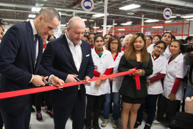 Dani Reiss, Canada Goose President & CEO (Right), and Kevin Chief (Left), Minister of Jobs and the Economy open Canada Goose's second manufacturing facility in Winnipeg. Photography by Lisa Waldner. (CNW Group/Canada Goose)
