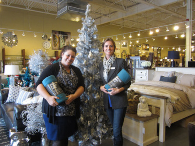 "Urban Barn employees, Hailey Jaillet and Nikki Gareau proudly posing with two of the 10,000 brand-new fleece blankets that will be donated to local community shelters through the retailer's ""Blanket the Country in Warmth"" campaign this winter. (CNW Group/Urban Barn)"