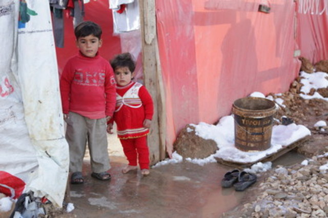 Winter has arrived in Lebanon's Bekaa valley. Four year old Abd Al Kader 4 and his sister Mona are refugee children living in tents in the cold. Mona doesn't have any winter boots, so she stays inside all day. (Photo: World Vision) (CNW Group/World Vision Canada)