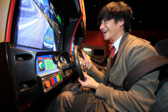 Student Tristan Pilar tries an old-school arcade game in the exhibition Game On 2.0, the history, culture and future of video games, now on at the Ontario Science Centre. The exhibition features over 150 playable games spanning 60 years. (CNW Group/Ontario Science Centre)