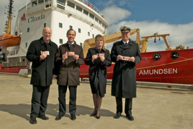Louis Fortier, Scientific Director of ArcticNet; Mark Carney, Governor of the Bank of Canada; Shelly Glover, Parliamentary Secretary to the Minister of Finance; and Marc Grégoire, Commissioner of the Canadian Coast Guard, in front of the CCGS Amundsen, site of the official issue of Canada's new $50 polymer notes. (CNW Group/Bank of Canada)