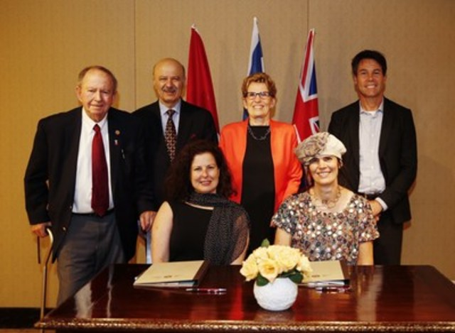 While in Jerusalem, Ontario Premier Kathleen Wynne (standing centre) witnessed the signing of an MOU between OCAD University's (OCAD U) Digital Media Research and Innovation Institute and Israel's Bezalel Labs Ltd. The MOU will create student and faculty exchanges to further collaborative solutions. At the signing were (standing from left), Monte Kwinter, Parliamentary Assistant to the Minister of Citizenship, Immigration and International Trade; Reza Moridi, Minister of Training, Colleges, and Universities and of Research and Innovation; and Dr. Eric Hoskins, Minister of Health and Long-Term Care. Signing the MOU were Carole Beaulieu, Associate Vice President of University Relations, OCAD U (seated left), and Liv Sperber, Vice President for International Affairs, Bezalel Academy of Arts and Design (seated right). Ontario is home to 18 of Canada's top 50 research universities, making it an attractive place to study and conduct innovative R&D. Photo credit: This official Ontario Government photograph is being made available only for publication by news organizations and/or for personal use by the subject(s) of the photograph. The photograph may not be manipulated in any way.  Queen's Printer for Ontario, 2016 (CNW Group/OCAD University)