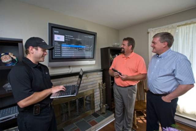 Premier David Alward (right) joins Jamie Canam, Bell Aliant Consumer Service Tech (left) on a FibreOP installation in Woodstock, NB. Bill Hogan (centre) was among the first customers connected to the network. (CNW Group/BELL ALIANT INC.)