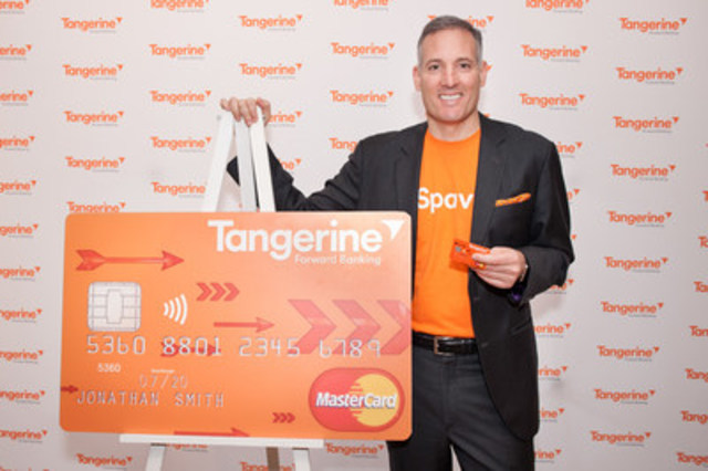 Tangerine president and CEO, Peter Aceto, shows off the new Tangerine Money-Back Credit Card, which was announced today at the bank's downtown Toronto café. Canadians can now register for a preview to get a first look at the card in advance of the 2016 launch. (CNW Group/Tangerine)