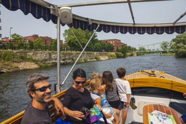 The Petit Navire, an electric powered boat, takes you on a cruise to explore the Lachine Canal through the history of Montreal. (CNW Group/Parks Canada)