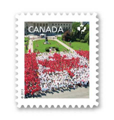 Canada Post today celebrates Canadian culture with five Canadian Pride definitive stamps, including one featuring more than 3,000 Winnipeggers who, dressed in red and white t-shirts, gathered together last Canada Day on grounds of the Manitoba legislature to form a Living Flag. (CNW Group/Canada Post)
