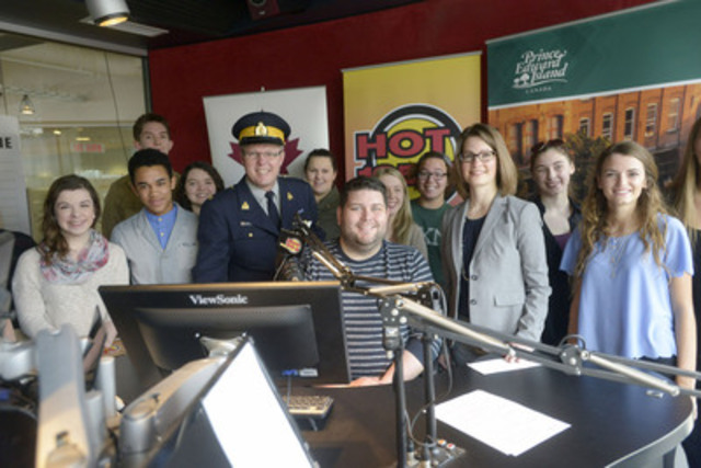 Amanda Dean, second right, Vice-President, Atlantic, Insurance Bureau of Canada, along with RCMP Staff Sergeant Mark Crowther and Matt MacLeod, morning host at Hot 105.5 Radio in Charlottetown surrounded by students from various P.E.I high schools who attended the launch of a campaign against distracted driving today. THE CANADIAN PRESS IMAGES/Brian McInnis (CNW Group/Insurance Bureau of Canada)
