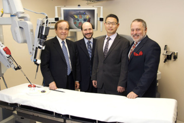 Humber River Regional Hospital physicians with the hospital's newly acquired da Vinci surgical robot: (l-r) Dr. Theadore Ptak, Gastroenterologist; Dr. Charles Radzinski, Head, Division of Urology; Dr. Peter Kong, Urologist; and Dr. Jack Barkin, Chief of Staff. (CNW Group/Humber River Regional Hospital)