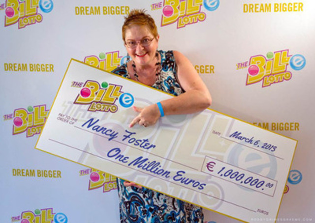 The BiLLe Lotto's newest million-Euro winner Nancy Foster of Smiths Falls, ON with her ceremonial cheque in Antigua. (CNW Group/The BiLLe Lotto Ltd.)