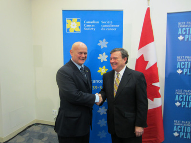 Peter Goodhand, Canadian Cancer Society President and CEO (left), Jim Flaherty, Federal Finance Minister ...