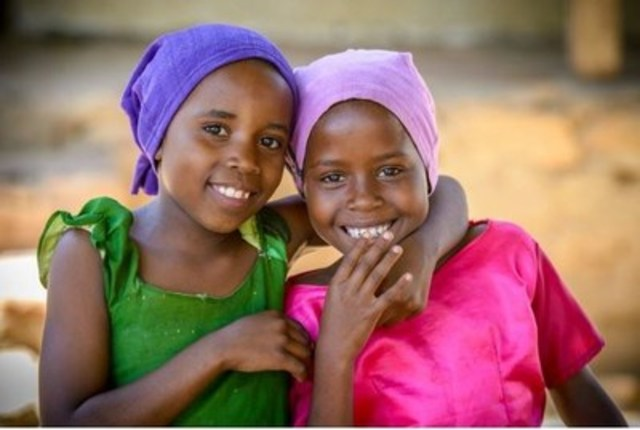 These girls in Tanzania demonstrate that friendship is the same all the world over. (CNW Group/World Vision Canada)