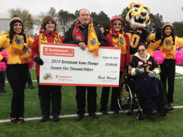 Aurora's Jessica Coriat is named the Hamilton Tiger-Cats 2013 Season Scotiabank Game Changer at the final game of the regular season, where she was awarded a $25,000 donation for the Toronto Rehab Foundation. (CNW Group/Scotiabank - Sponsorships & Donations)