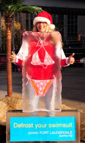 "Greater Fort Lauderdale Heated up Toronto with ""Defrost Your Swimsuit"" Event. Arlene MacKenzie of Toronto strikes a pose with frozen bikini. (CNW Group/Greater Fort Lauderdale)"