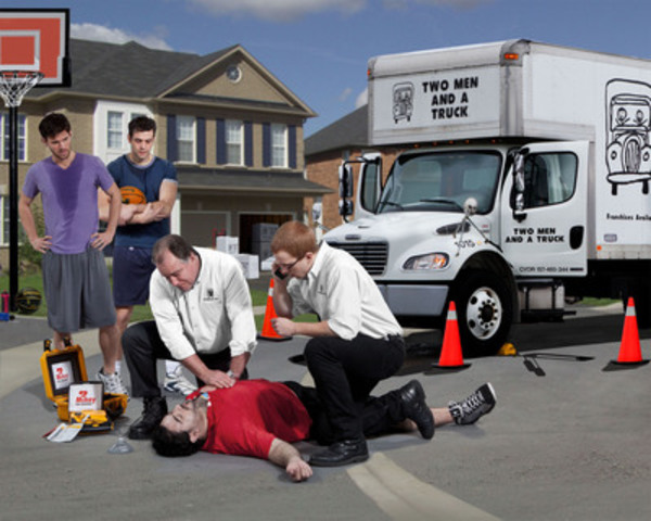 SIMULATED SAVE - MIKEY defibrillators and trained personnel are now on-board TWO MEN AND A TRUCK® moving trucks across Canada, giving anyone experiencing sudden cardiac arrest a second chance at life. In this simulated save, two movers apply a MIKEY and CPR to save a young basketball player's life. (Photo Credit: Paul Casselman) (CNW Group/Two Men and a Truck)