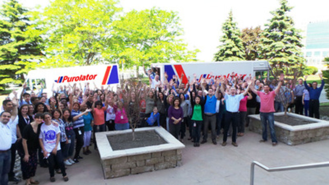 Purolator employees celebrating a successful Purolator Tackle Hunger Week. (CNW Group/Purolator Inc.)