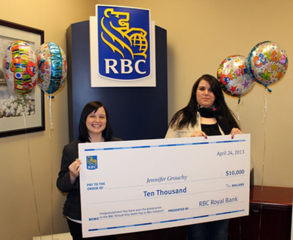 """RBC Virtual Visa Debit """"Pay to Win"""" grand prize winner Jennifer Grouchy (Grand Falls-Windsor, Newfoundland and Labrador) accepts her $10,000 cheque from local RBC branch manager Ashley MacDonald. RBC Virtual Visa Debit [http://www.rbcroyalbank.com/visa-debit/eg-lp.html] cardholders pay securely by debit directly from their bank accounts for online, telephone or mail order purchases. (CNW Group/RBC)"""