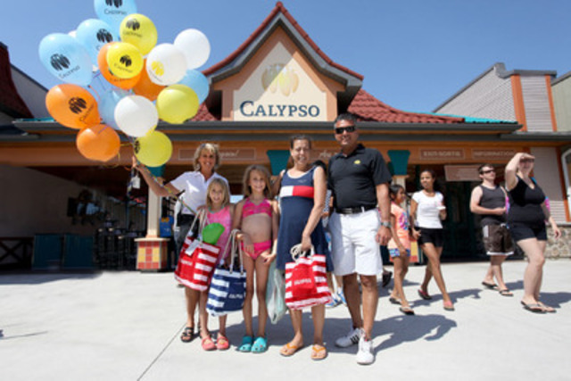 Greeting of the one millionth visitor at the Calypso Theme Waterpark. In the middle, the Weilbrenner-Masson family, Mahée, Daphnée and their mother Sophie, surrounded by Ginette Robert, Vice-President, Sales and Marketing at Valcartier Vacation Village and Sylvain Lauzon, Executive Vice-President at Calypso. (CNW Group/Calypso Park)