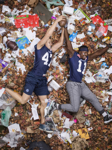 Toronto Argonauts Natey Adjei and James Yurichuk pose in the newly expanded 7 Days of Garbage exhibit, brought by Glad and the City of Toronto to Union Station's Great Hall November 3rd. The exhibition of photographs pairs life with art to spark a national conversation about the sheer volume of waste we produce. (CNW Group/GLAD Canada)