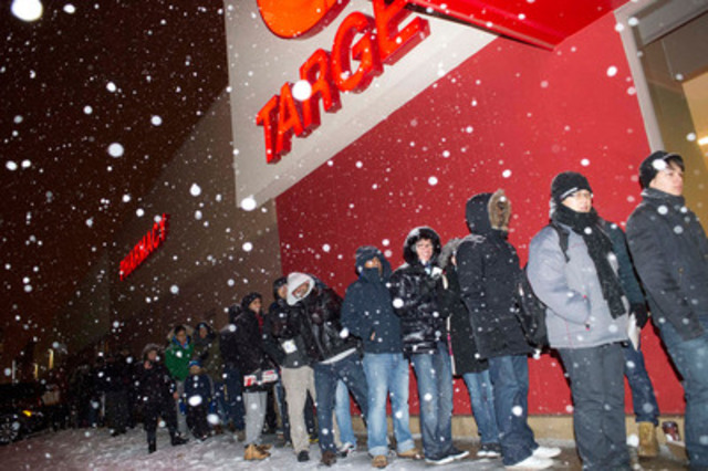 Hundreds of guests line up at Target stores to grab unbeatable deals on electronics, home products, apparel and more. Target is celebrating its first Boxing Day by offering incredible Bullseye Boxing Week deals all week long. (CNW Group/Target Canada)