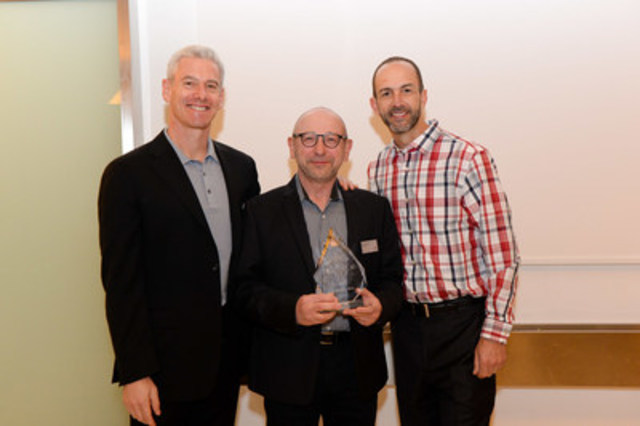 Autodesk's Senior Vice President of Worldwide Sales & Services, Steve Blum and Vice President of American Sales, Ray Savona honour the President of SolidCAD Solutions, Michael Kugan with the Platinum Club Award 2016. (CNW Group/SolidCAD Solutions)