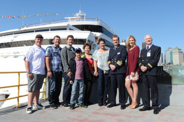 The 100,000th Maasdam passenger to disembark in Montréal, Ms. Marianne Visser from California, surrounded by her family, the ship's captain, Mr. Ane Jan Smit and Port of Montréal representatives. (CNW Group/Tourisme Montréal)
