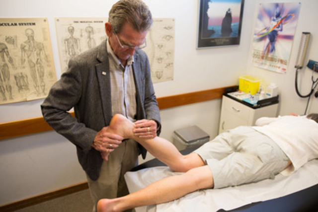 Dr. Jack Taunton, MD, examines a patient with chronic Achilles tendinosis (CNW Group/RepliCel Life Sciences Inc.)