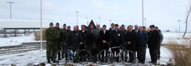 Government representatives, members of the Canadian Armed Forces, Veterans and representatives from Wounded Warriors Canada gather to announce the Highway of Heroes Bike Ride. (CNW Group/Wounded Warriors Canada)