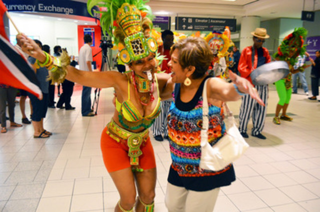 Surprised guests and excitement fill Terminal 3 as Toronto Pearson kicks-off celebrations for the 45th Scotiabank Toronto Caribbean Carnival on Tuesday. (CNW Group/Greater Toronto Airports Authority)